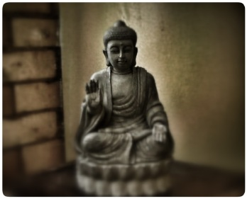 buddha on a stool