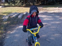 bundled up to ride + run with mom