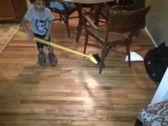 borrow daddy's slippers + interrupt mommy's cleaning to play broom hockey