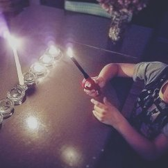"king k + his ""flamethrower,"" lighting the 3rd candle last night!"